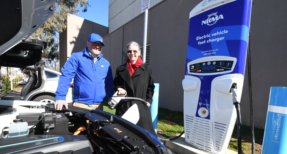 HEY CHARGER: The NRMA's Jason Simmons and Nell Payne launch the state's 16th electric vehicle charging station in Orange. Photo: JUDE KEOGH 0709jkelectric6