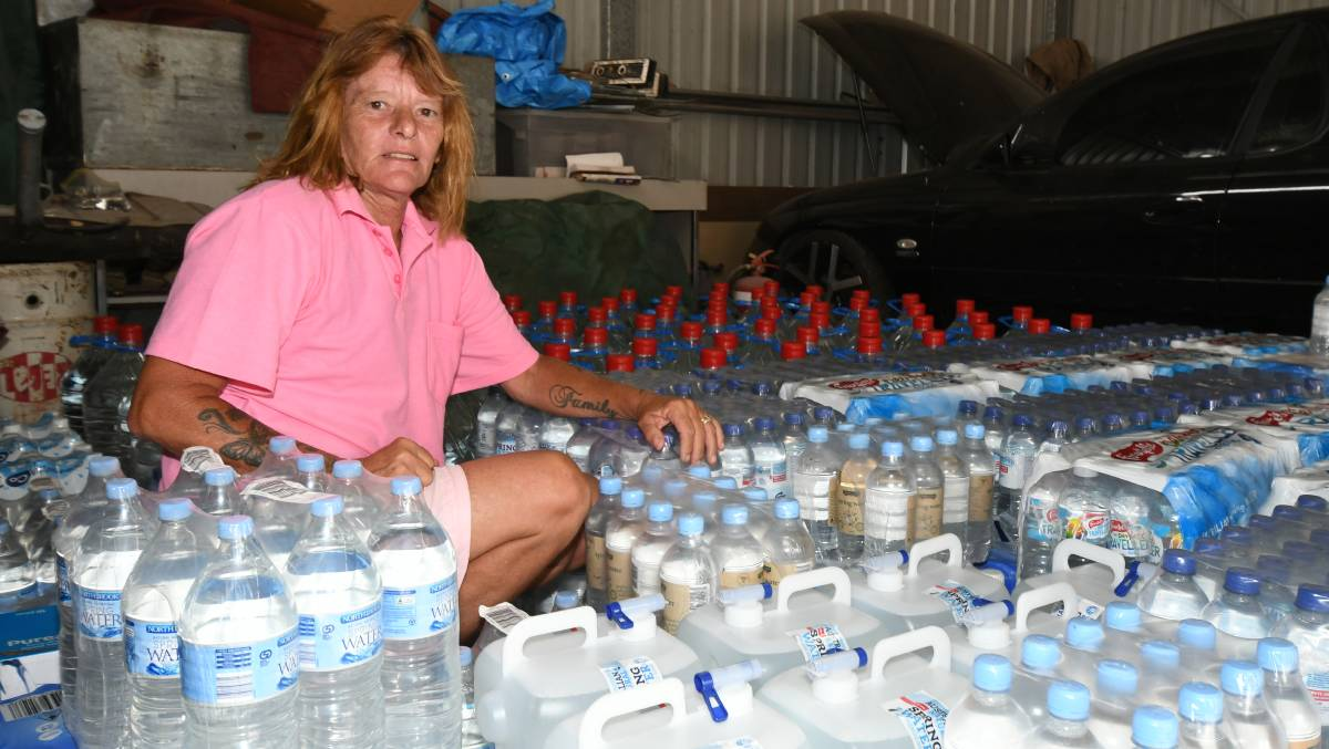Maree Glohe with some of the water donated by people in Orange. Photo: Carla Freedman