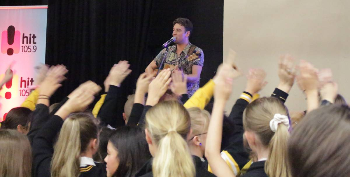 GET THE CROWD MOVING: Taylor Henderson playing to 200-odd adoring fans at Orange High School. Photo: MAX STAINKAMPH