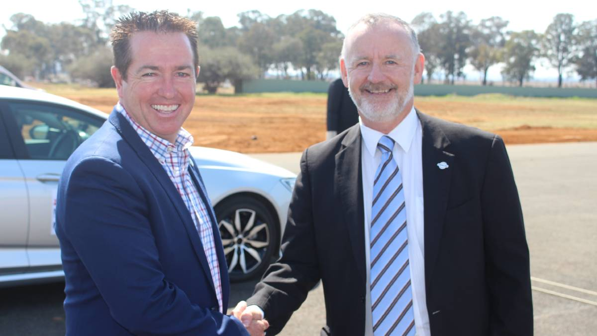 CUDAL COUP: Minister for regional transport and roads Paul Toole with Centre for Road Safety executive director Bernard Carlon. Photo: MAX STAINKAMPH