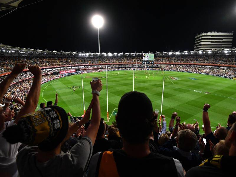 Fans enjoy the historic AFL grand final that was played at the Gabba.