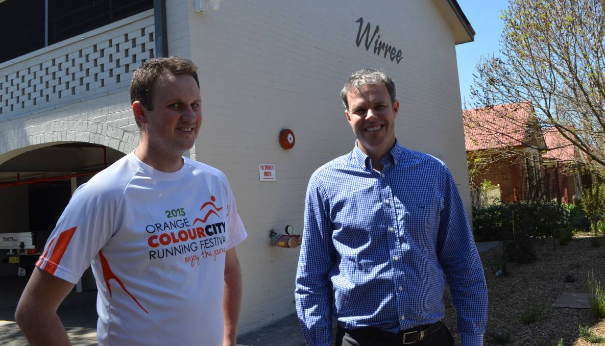 HELPING HAND: Colour City Running Festival's David Gibson with Housing Plus's business development manager Justin Cantelo outside the organisation's homeless accommodation Wirri, in March Street. Photo: TRACEY PRISK 1006tprunningfest1