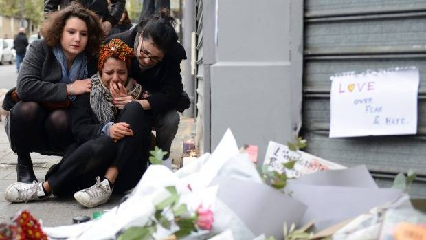 TEARS IN PARIS: A woman cries near the Le Petit Cambodge restaurant, the site of one of the attacks.