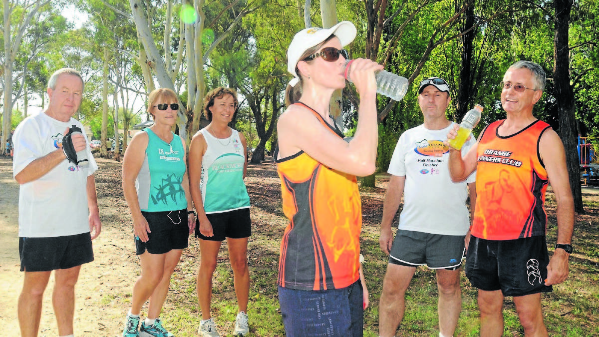 NO SWEAT: Orange  Runners' Club members Graham Fahy, Sharon Fahy, Lynda Chapman, James Hennesy, John Moss, and Kim Jarvis (front) take on plenty of fluids during their training. Photo: Luke Schuyler