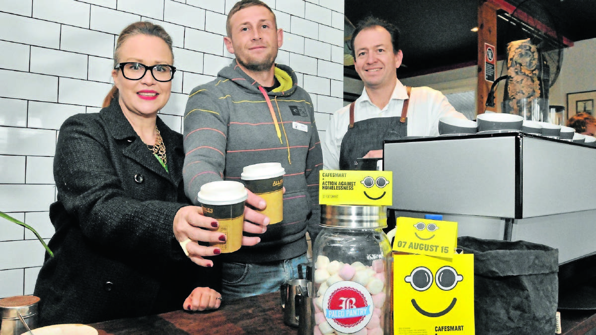 HELPING HOMELESS: StreetSmart's Lindy Thompson, with Veritas House case worker Scott Hanrahan and Byng Street Cafe owner Jeremy Norris who are raising money for homeless people in Orange. Photo: JUDE KEOGH.