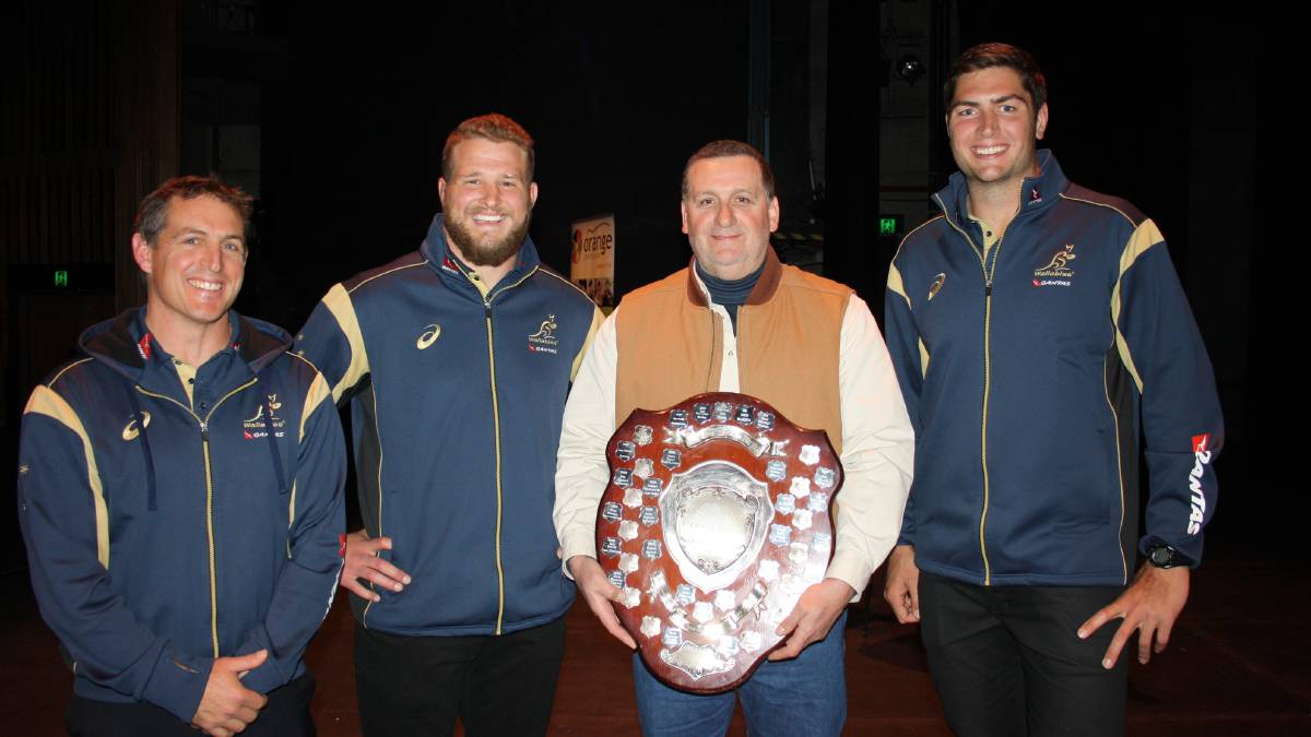 SHIELDED: The 2013 Orange Credit Union Sportsperson of the Year Dave Oates (second right) is presented with the shield by Wallabies' head performance coach Scott Murphy (left) and players James Slipper (second left) and Rob Simmons (right). Photo: MICHELLE COOK 0805mcawards1