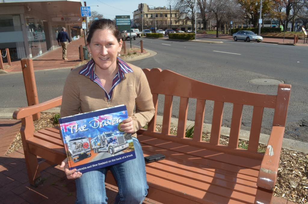Former Orange resident Alice Mabin with her second book about the nation's truck drivers. Photo: DECLAN RURENGA